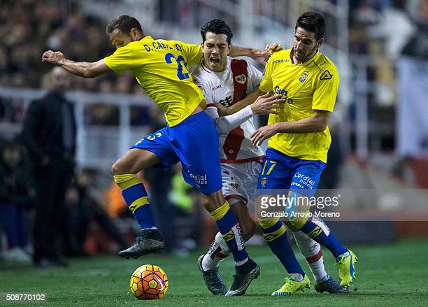 Nicolas Fedor Flores alias Miku of Rayo Vallecano de Madrid is tackled by Daniel Castello of UD Las Palmas and his teammate Pedro Bigas during the La...