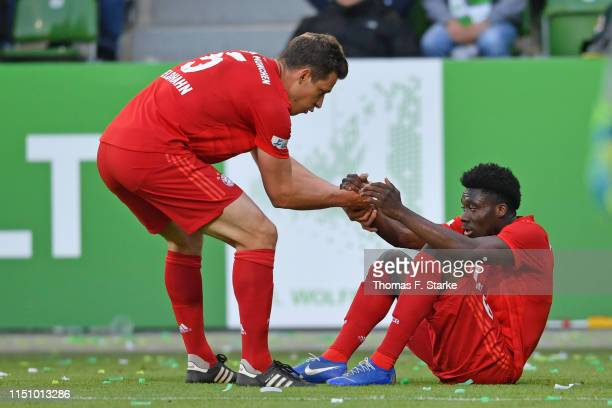 Nicolas Feldhahn and Alphonso Davies of Muenchen look dejected during the Third League Playoff First Leg match between VfL Wolfsburg II v Bayern...