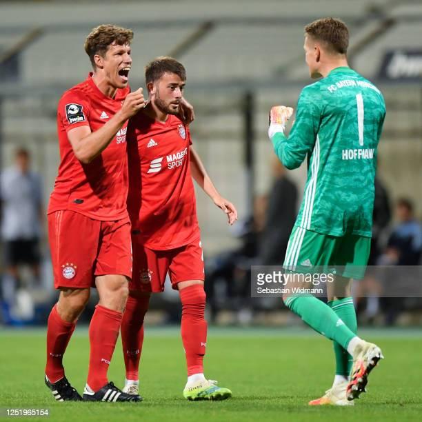Nicolas Feldhahn, Mert Yilmaz and Ron-Thorben Hoffmann of Bayern Muenchen II celebrate after winning the 3. Liga match between Bayern Muenchen II and...