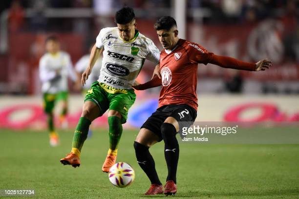 Nicolas Fernandez of Defensa y Justicia and Alan Franco de Independiente fight for the ball during a match between Independiente and Defensa y...