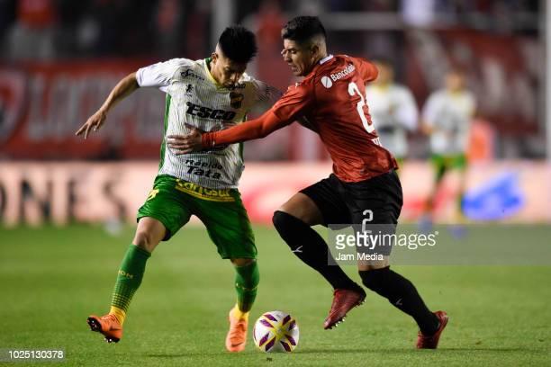 Nicolas Fernandez of Defensa y Justicia and Alan Franco de Independiente fight for the ball during a match between Independiente and Defensa y...
