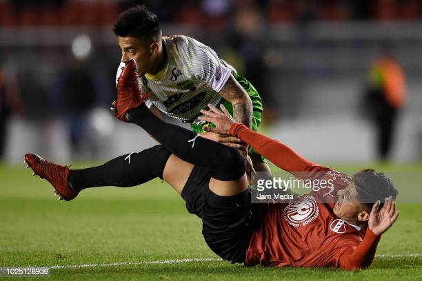 Nicolas Fernandez of Defensa y Justicia and Alan Franco of Independiente fight for the ball during a match between Independiente and Defensa y...