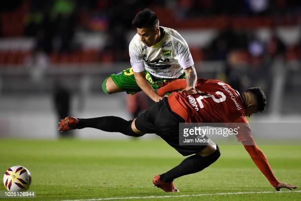 Nicolas Fernandez of Defensa y Justicia and Alan Franco of Independiente fight for the ball during a match between Independiente and Defensa y...