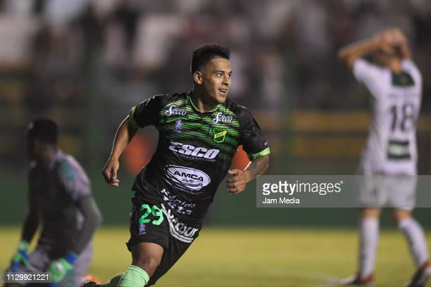 Nicolas Fernandez of Defensa y Justicia celebrates after scoring his side's third goal during a match between Defensa y Justicia and Banfield as part...