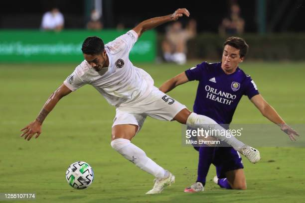 Nicolas Figal of Inter Miami and Mauricio Pereyra of Orlando City fight for the ball during a match between Orlando City and Inter Miami as part of...