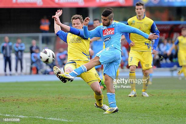 Nicolas Frey of AC Chievo Verona competes with Lorenzo Insigne of SSC Napoli during the Serie A match between AC Chievo Verona and SSC Napoli at...