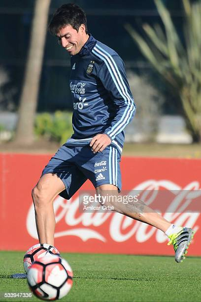 Nicolas Gaitan drives the ball during a training session at Argentine Football Association 'Julio Humberto Grondona' training camp on May 24 2016 in...
