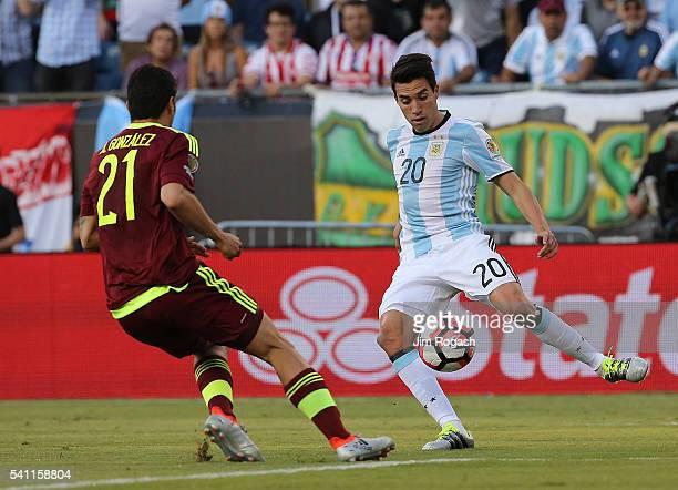 Nicolas Gaitan of Argentina defends against Alexander Gonzalez of Venezuela in the second half during the 2016 Copa America Centenario quarterfinal...