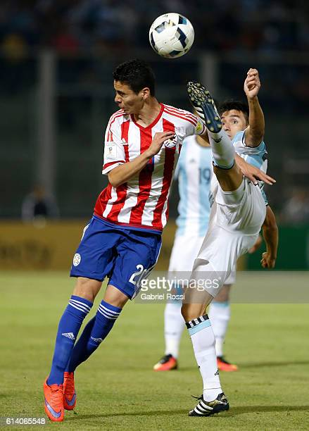 Nicolas Gaitan of Argentina fights for the ball with Miguel Almirón of Paraguay during a match between Argentina and Paraguay as part of FIFA 2018...