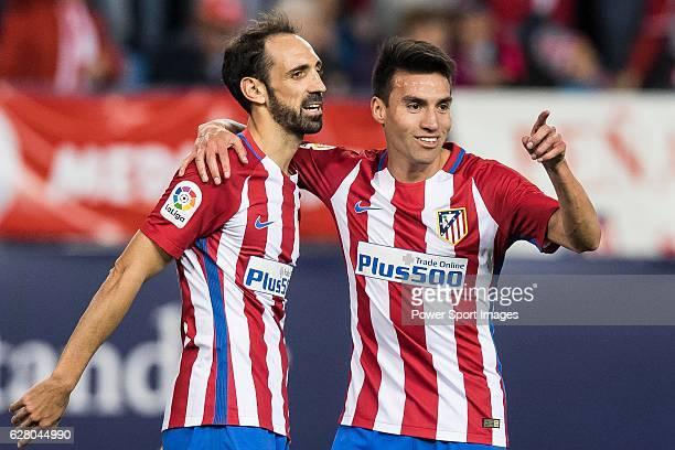Nicolas Gaitan of Atletico de Madrid celebrates with teammate Juanfran during their La Liga match between Atletico de Madrid and Granada CF at the...