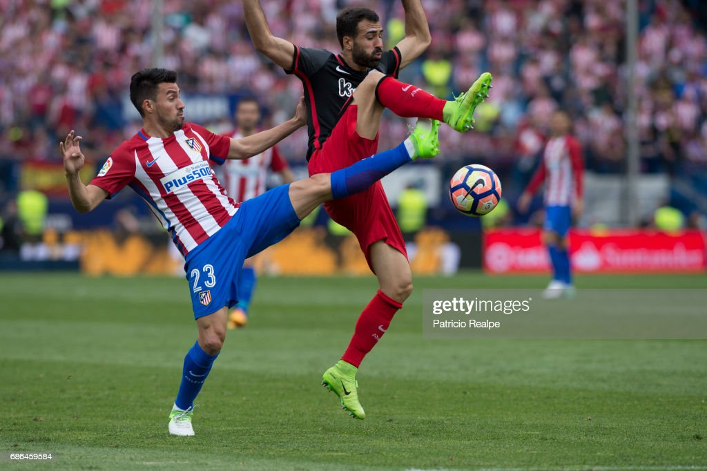 Nicolas Gaitan of Atletico de Madrid figths the ball with Balenciaga of Athletic Club Bilbao during the La Liga match between Club Atletico de Madrid and Athletic Club Bilbao at Vicente Calderon stadium on May 21, 2017 in Madrid, Spain.