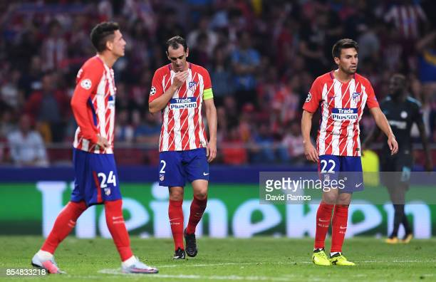 Nicolas Gaitan of Atletico Madrid and team mates look dejected after Chelsea score their second goal during the UEFA Champions League group C match...