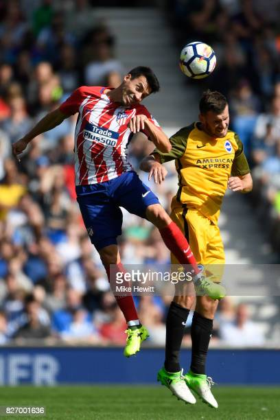 Nicolas Gaitan of Atletico Madrid challenges Pascal Gross of Brighton during a Pre Season Friendly between Brighton Hove Albion and Atletico Madrid...