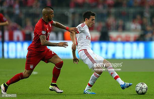 Nicolas Gaitan of Benfica holds off Arturo Vidal of Bayern Munich during the UEFA Champions League quarter final first leg match between FC Bayern...