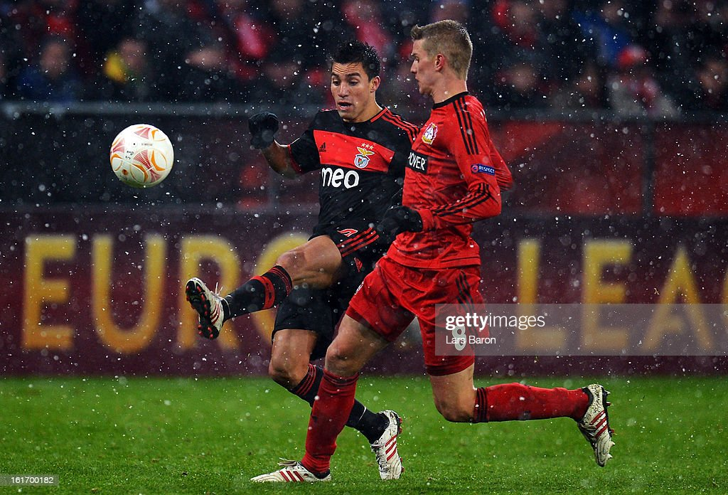 Nicolas Gaitan of Benfica is challenged by Sven Bender of Leverkusen during the UEFA Europa League Round of 32 first leg between Bayer 04 Leverkusen and SL Benfica at BayArena on February 14, 2013 in Leverkusen, Germany.