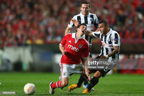 Nicolas Gaitan of Benfica is fouled by Danny Simpson of Newcastle United during the UEFA Europa League Quarter Final First Leg match between Benfica...
