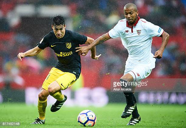 Nicolas Gaitan of Club Atletico de Madrid competes for the ball with Mariano Ferreira of Sevilla FC during the match between Sevilla FC vs Club...