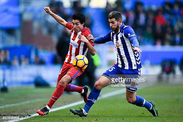 Nicolas Gaitan of Club Atletico de Madrid competes for the ball with Theo Hernandez of Deportivo Alaves during the La Liga match between Deportivo...