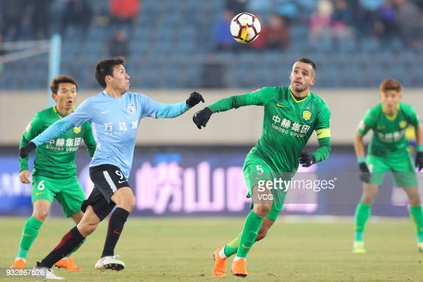 Nicolas Gaitan of Dalian Yifang and Renato Augusto of Beijing Guoan compete for the ball during the 2018 Chinese Football Association Super League...