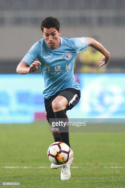 Nicolas Gaitan of Dalian Yifang drives the ball during the 2018 Chinese Football Association Super League first round match between Shanghai SIPG and...
