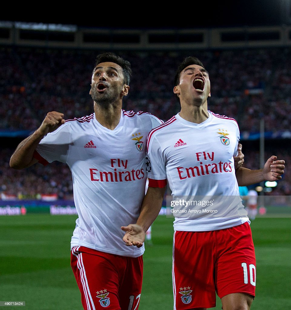 Nicolas Gaitan (R) of SL Benfica celebrates scoring their opening goal with teammate Jonas Goncalves (L) during the UEFA Champions League Group C match between Club Atletico de Madrid and SL Benfica at Vicente Calderon Stadium on September 30, 2015 in Madrid, Spain.