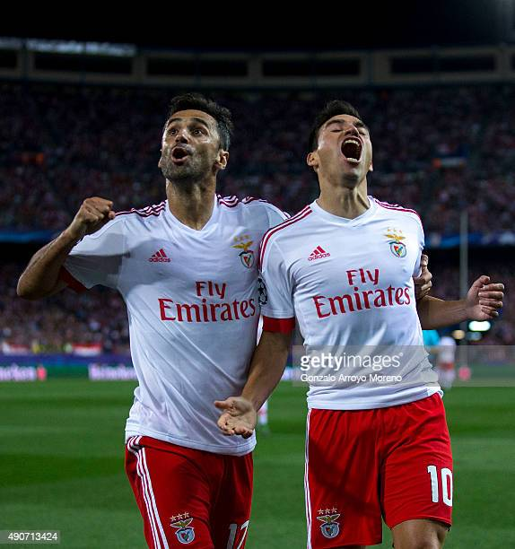 Nicolas Gaitan of SL Benfica celebrates scoring their opening goal with teammate Jonas Goncalves during the UEFA Champions League Group C match...