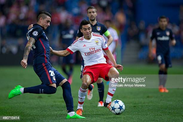 Nicolas Gaitan of SL Benfica competes for the ball with Jose Maria Gimenez of Atletico de Madrid during the UEFA Champions League Group C match...