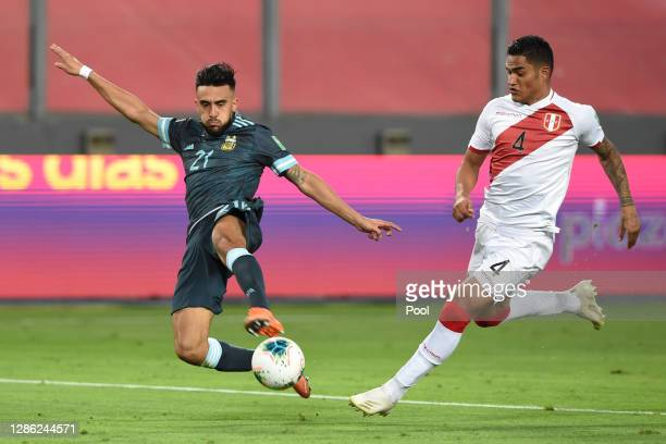 Nicolas Gonzalez of Argentina tries to take a shot as Anderson Santamaria of Peru defends during a match between Peru and Argentina as part of South...