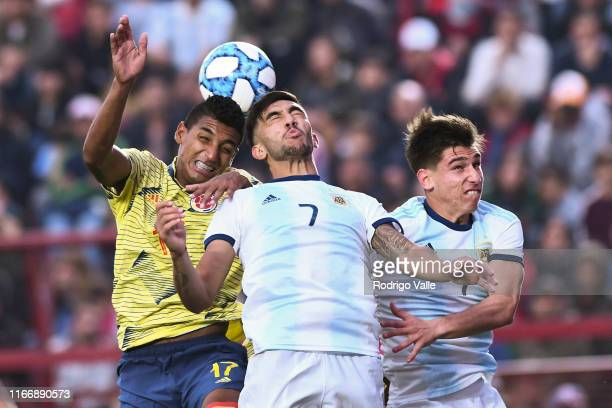 Nicolas Gonzalez of Argentina U23 fights for the ball with Gabriel Fuentes of Colombia U23 during a friendly match between Argentina U23 and Colombia...