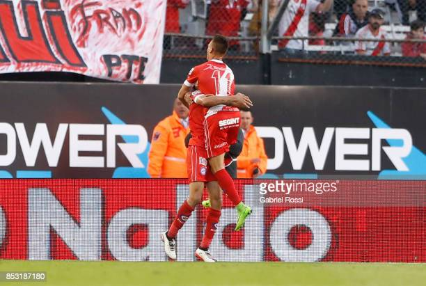 Nicolas Gonzalez of Argentinos Juniors celebrates with teammate Braian Romero after scoring the first goal of his team during a match between River...