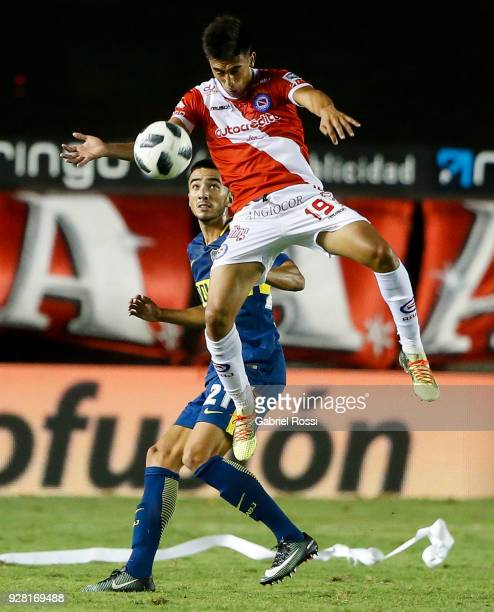 Nicolas Gonzalez of Argentinos Juniors fights for the ball with Agustin Heredia of Boca Juniors during a match between Argentinos Juniors and Boca...
