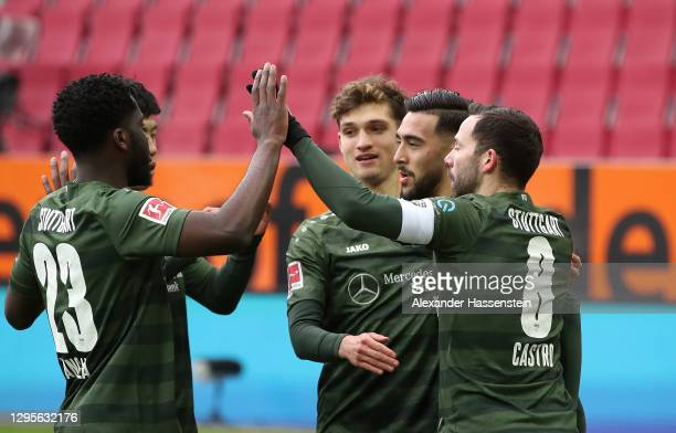 Nicolas Gonzalez of VfB Stuttgart celebrates with Orel Mangala, Gonzalo Castro and team mates after scoring their side's first goal during the...