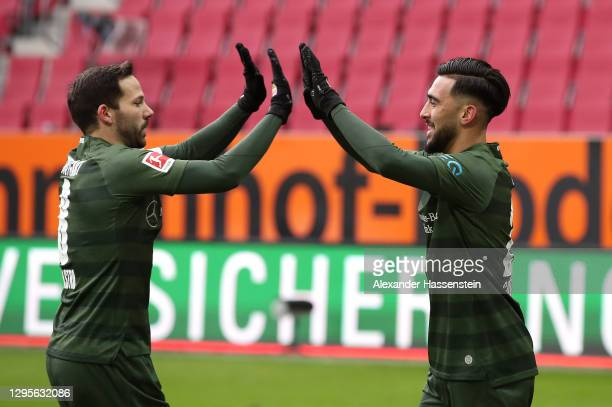 Nicolas Gonzalez of VfB Stuttgart celebrates with team mate Gonzalo Castro after scoring their side's first goal during the Bundesliga match between...