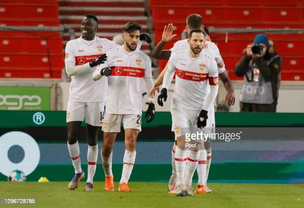 Nicolas Gonzalez of VfB Stuttgart celebrates with team mates after scoring their side's first goal during the Bundesliga match between VfB Stuttgart...