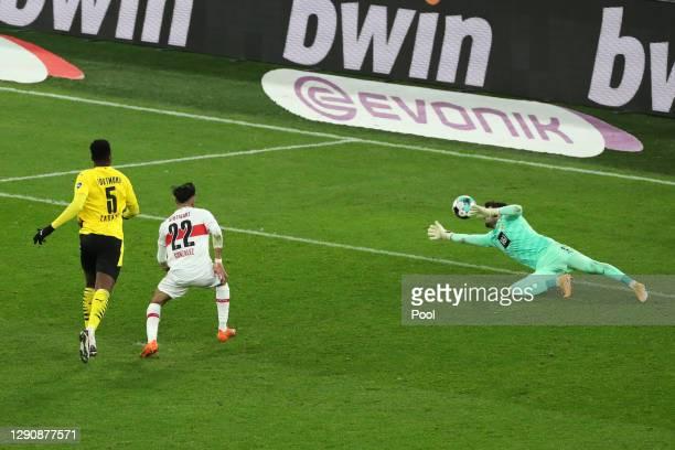 Nicolas Gonzalez of VfB Stuttgart scores his team's fifth goal past Roman Burki of Borussia Dortmund during the Bundesliga match between Borussia...