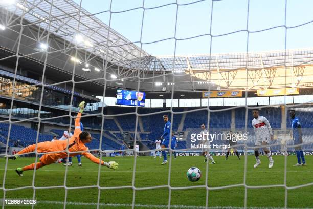 Nicolas Gonzalez of VfB Stuttgart scores his team's first goal past Oliver Baumann of TSG 1899 Hoffenheim during the Bundesliga match between TSG...