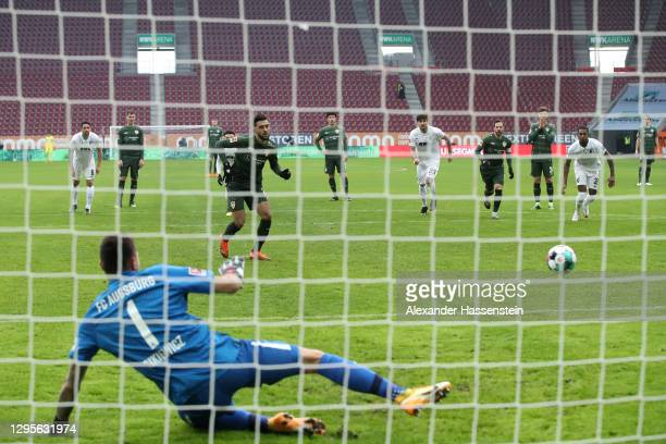 Nicolas Gonzalez of VfB Stuttgart scores their side's first goal from the penalty spot past Rafal Gikiewicz of FC Augsburg during the Bundesliga...