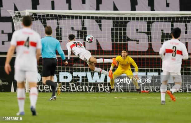 Nicolas Gonzalez of VfB Stuttgart scores their side's first goal post Yann Sommer of Borussia Moenchengladbach during the Bundesliga match between...