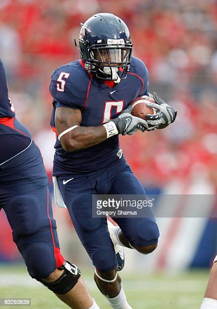 Nicolas Grigsby of the Arizona Wildcats carries the ball during the game against the Washington Huskies on October 4 2008 at Arizona Stadium in...
