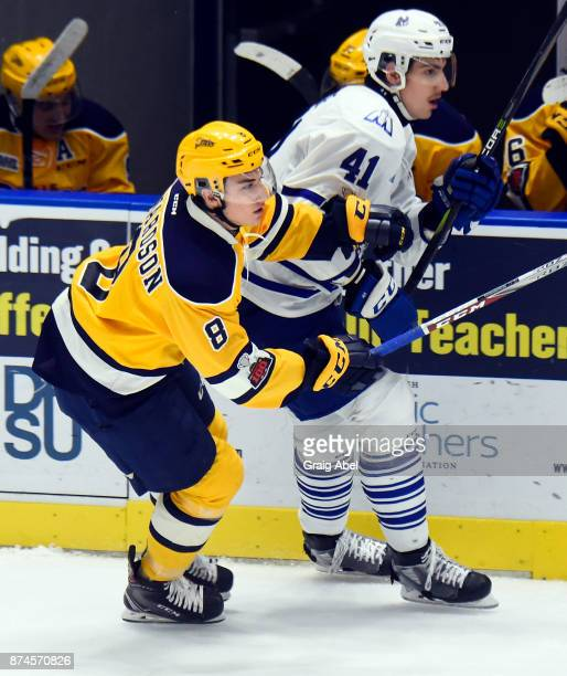 Nicolas Hague of the Mississauga Steelheads battles with Carson Edwardson of the Erie Otters during game action on November 15 2017 at Hershey Centre...