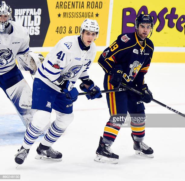 Nicolas Hague of the Mississauga Steelheads battles with Jason Wilms of the Barrie Colts during OHL game action on December 8 2017 at Hershey Centre...