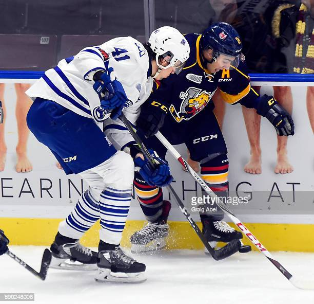 Nicolas Hague of the Mississauga Steelheads battles with Lucas Chiodo of the Barrie Colts during OHL game action on December 8 2017 at Hershey Centre...