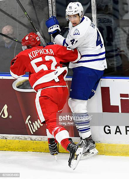 Nicolas Hague of the Mississauga Steelheads takes a hit from Jack Kopacka of the Sault Ste Marie Greyhounds during game action on November 25 2016 at...