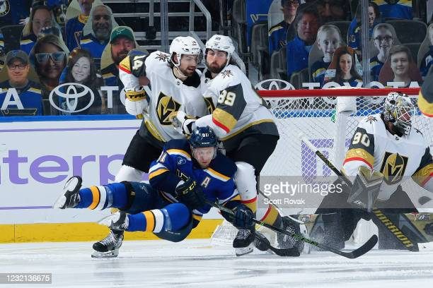 Nicolas Hague of the Vegas Golden Knights and Alex Tuch of the Vegas Golden Knights defend against Vladimir Tarasenko of the St. Louis Blues on April...