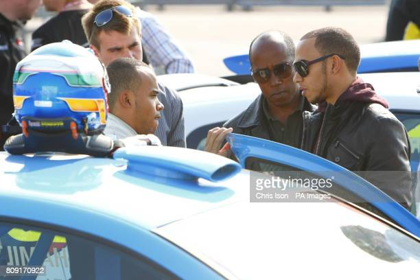 Nicolas Hamilton brother of former Formula One champion Lewis Hamilton gets some last minute advice from his brother and father Anthony before...