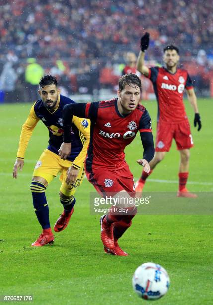 Nicolas Hasler of Toronto FC Gonzalo Veron of New York Red Bulls chase the ball during the second half of the MLS Eastern Conference Semifinal Leg 2...