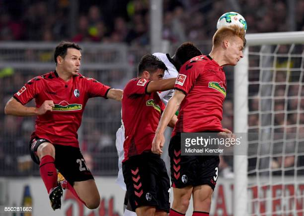 Nicolas Hoefler Marco Terrazzino and Philipp Lienhart of SC Freiburg try to make a goal during the Bundesliga match between Sport Club Freiburg and...