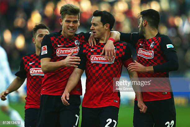 Nicolas Hoefler of Freiburg celebrates his team's first goal with team mates Florian Niederlechner and Vincenzo Grifo during the Second Bundesliga...