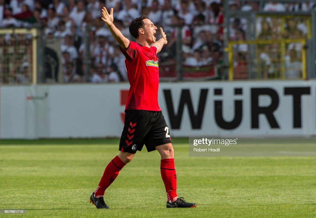 #27 Nicolas Hoefler of Freiburg celebrates the win during the Bundesliga match between Sport-Club Freiburg and FC Augsburg at Schwarzwald-Stadion on May 12, 2018 in Freiburg im Breisgau, Germany.