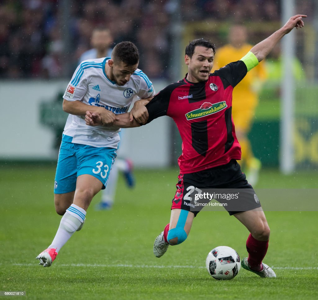 Nicolas Hoefler of Freiburg is challenged by Donis Avdijaj of Schalke during the Bundesliga match between SC Freiburg and FC Schalke 04 at Schwarzwald-Stadion on May 7, 2017 in Freiburg im Breisgau, Germany.